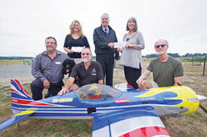 The Victoria Radio Control Modelers Society raised more than $24,000 at their recent air show in Central Saanich. From left: Dan Deringer, president of Santas Anon.; Christine Hewitt, executive director of Santas Anon.; Mike Scholefield of VRCMS; Gordon Benn, president of the board for the SPHF; Karen Morgan SPHF executive director, and; Jack Price of VRCMS. Steven Heywood