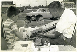 The Author's dad and brothers making repairs to a free-flight  model at the U.S. Nationals sometime in the early 1960s. Read more at https://www.flyingmag.com/blogs/going-direct/domestic-drone-casualties#I8K3gmviFBlO7UIV.99