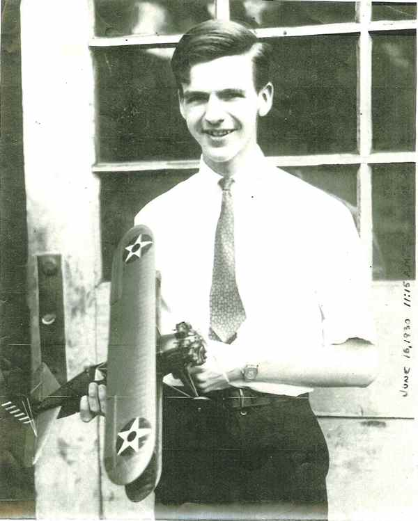 A young man smiles at the camera holding his complete P-12B.  The photo is dated June 16, 1930 11:15 AM.