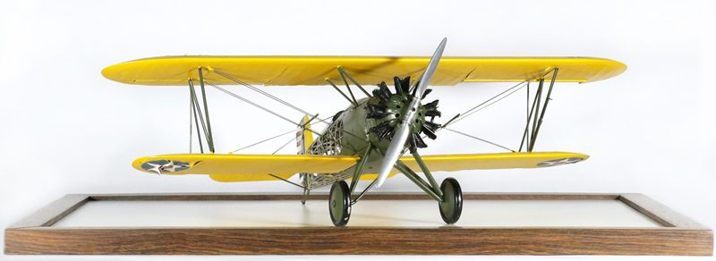 The Boeing P-12B is done in basic military markings, yellow wings and an olive green fuselage.
